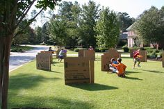 Nerf gun course made out of cardboard and wooden stakes.