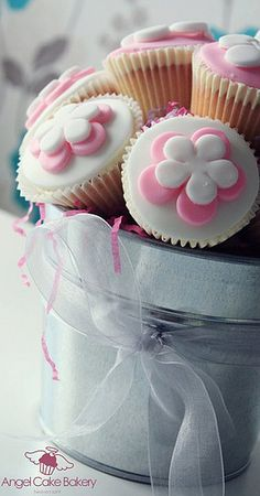 These cupcake bouquets, flower and other cupcakes are by the Coleraine, UK custom dessert company Angel Cake Bakery