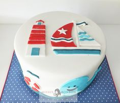 The lighthouse and boat definitely completed the look and feel of the nautical themed cake.