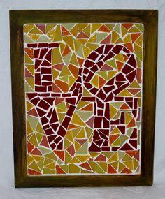 Quadro feito artesanalmente com pastilhas de vidra e técnica de mosaico.