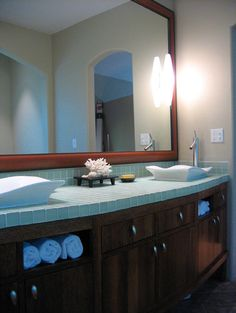 Tile counter tops. Love these sinks