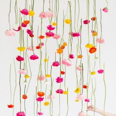 Create a floral masterpiece with this DIY hanging flower installation!
