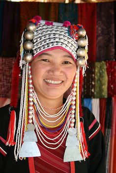 Woman in traditional headdress of the Akha tribe. The Akha are an indigenous hill tribe who live in small villages at higher elevations in the mountains of Thailand, Burma, Laos, and Yunnan Province in China. Tribes Of The World, Wedding Headdress, Northern Thailand, Folk Costume, African Women, Woman Face, Traditional Dresses, Laos, Beautiful People