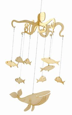 Not a papercut, but I want to use this as inspiration for an undersea mobile. From Antipodean Love (Fishy Mobile) $59.95