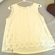 EM Tank Top Off white colored tank top with lace overlay on front. Very comfortable. Size Medium Tops Tank Tops