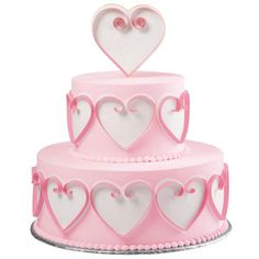 Flirtatious Hearts Tiered Cake - Here's a great example of the presence Sugar Sheets! decorations can bring to a simple iced cake! The swirling quilled hearts literally stand out on the cake sides and the heart topper. The design is perfect for weddings, showers, anniversaries and more!