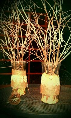 DYI Wedding decorations, vases with pine shavings and pine cones, burlap lace and pearl deco :)