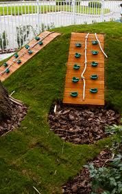We can't get rid of the slope so I like the idea of using it by incorporating a slide and/or a climbing wall.