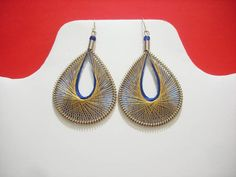 These earrings are gorgeous and light weight, such an amazing display of work. Thread Earrings Handmade with Alpaca silver wire and Silk Thread. The length of these earrings is 2 inches ( Small Size ). The length of these earrings is 3.5 inches.( Large Size).