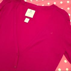 Aerie v neck cardigan Classic Aerie cardigan in a dark pink. The logo placement has caused the threads near it to stretch a little and there are some loose threads at the edges of the pockets. Minimal pilling is not noticeable. Very good used condition! American Eagle Outfitters Sweaters Cardigans