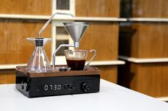 Alarm clocks have long been our sworn enemies. After all, they exist for one purpose: tearing us from sweet, sweet sleep. But one alarm clock is looking to extend the olive branch. Meet the Barisieur, an impressively designed alarm clock/coffee maker combo that will let you wake up to a freshly brewed cup of coffee, right on your nightstand.