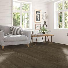 Brown, medium wood-look flooring. Pergo Extreme Wood Originals in Mineral Ash
