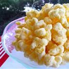 Angel Poop recipe: 1 (12 0z) pkg white chocolate chips + 2 (8 oz) bags butter-flavored corn puff snacks.