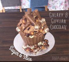 Galaxy & Guylian giant chocolate cupcake Giant Chocolate, Chocolate Cupcakes, Pudding, Candy, Desserts, Food, Tailgate Desserts, Deserts, Puddings
