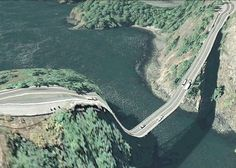 "From Postcards From Google Earth  -""The images are screenshots from Google Earth. They are glitches that occur when the 2d satellite imagery and 3d terrain don't line up quite right, or structures such as bridges get projected down onto the terrain below, creating fabulous and unintentional distortions""  Clement Valla"