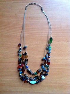 Handmade colorful necklace with plastic jewels. 100% of sales go to support the Youth Education Network of Kenya - www.yenkenya.org