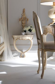 Shown here used as a bedside table in an antiqued ivory finish together with accents of antiqued gold to the ornate carvings. Equally as comfortable in a hallway as a console table or by a sofa as a side table. Find the High End Ornate Wall Mounted Bedside Table with small drawer is a versatile but beautifully unique table for any room in the house. Truly striking in any setting. Italian design at its finest, a striking statement piece!