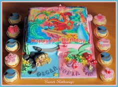 Peter Pan and Tinkerbel Joint birthday cake and cupcakes could do if I decide to have Danika's bday party with cys since her bday is 5 days before Christmas