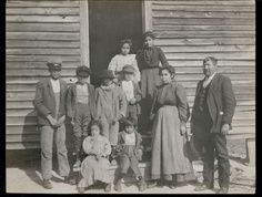 r-l David Adam and Della George Harris,  girls in doorway Sallie and Cora Brown,John Jack Sanders, very end with the hat and John William Brown jr (Jack). the rest are unknown.  Cora and John Brown died in Influenza epidemic in 1918