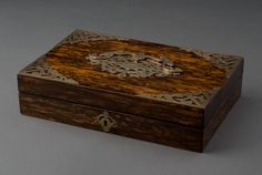 An old English rosewood keepsake box with engraved brass mounts and shaped brass handle. Circa 1880.