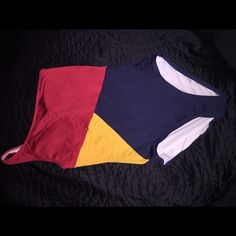 Tommy Hilfiger color block bathing suit- Size 4 Beautiful color block bathing suit. Red top, golden yellow center and navy blue bottom. Lining includes built in breast pads. Tommy Hilfiger Swim One Pieces