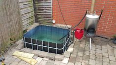 http://www.klusidee.nl/Forum/houtgestookte-jacuzzi-hottub-van-ibc-container-t97750.html
