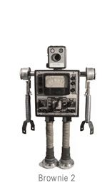 An artist that makes Robots.  Not only do i want one.. i want to make one so badly.