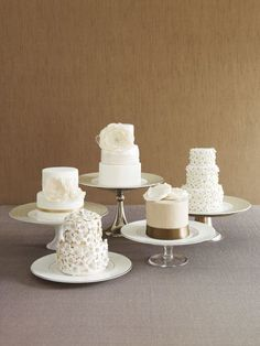 Order Mini Cakes    Have the cakes served tableside as you would any other course. Or display them in the center of the reception -- all stacked up so that they look like one big cake. Then invite guests to help themselves!