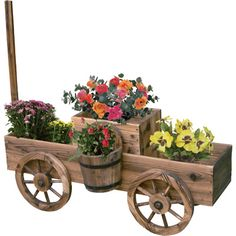 Wooden Wagon Planter — Get Your Garden Rolling - Landscaping Ideas Wooden Garden Planters, Outdoor Planters, Flower Planters, Flower Pots, Garden Crafts, Garden Projects, Wood Projects, Garden Tools, Garden Ideas