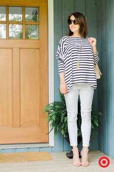 The skinny look meets baby bump with Liz Lange for Target Maternity under-the-belly jeans. Blogger Caitlin Kruse of Style Within Reach carries off the look with ease, pairing the white cropped jeans with chic ankle-strap high heel sandals, then topping it all off with a floaty striped top and a couple of well-chosen accessories