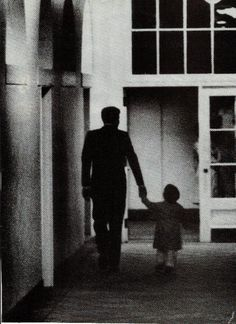 JFK and JFK Jr. walking in the White House 1963