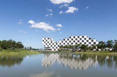 https://www.dezeen.com/2017/10/20/vo-trong-nghia-trees-chequerboard-facade-fpt-university-hanoi/