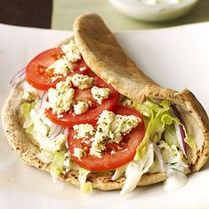 Veggie Gyro - Here's a quick and easy vegetarian version of the popular Greek sandwich. Slices of lettuce, onion, tomato and cheese are flavored with the traditional flavors of cucumber, garlic, dill and feta. Vegetarian Recipes, Cooking Recipes, Healthy Recipes, Yummy Recipes, Cooking Tips, Yummy Food, Greek Sandwich, Sandwiches, Comida Latina
