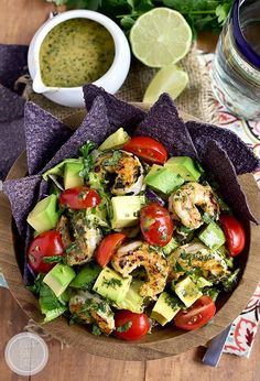 Shrimp and Avocado Taco Salad is a delicious gluten-free salad recipe with a shrimp marinade that doubles as the salad dressing. Fresh, easy, and filling! | iowagirleats.com