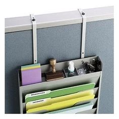 Get those space-hogging flat items off your desk, but keep them within reach in a file rack