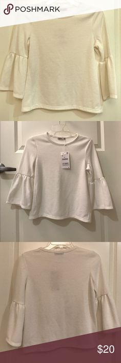BNWT Cream Zara Shirt with Flare Sleeves Cream Flared Shirt from Zara NWT. Super cute! Would go nice with flared jeans or a pair of mid rise skinny jeans and some Stan smith's! Open to offers! Listed on Ⓜ️ercari as well! Zara Tops