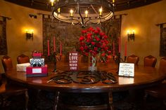 Red & black sign-in table with large wooden monogram for guests to sign, wedding typography on wooden signs, and handmade card box | David De Dios Photography | villasiena.cc