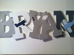 Airplane themed wooden letters for nursery in light blue, gray, white  and navy. $14.00, via Etsy.