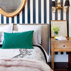 """The right yin to yang with dapper, navy-and-white #stripes in a bedroom? Blush-dyed fur and peacock green of course! #eclecticbedrooms #pinkandgreen…"""