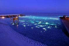 Huvafen Fushi – Maldives  The T-shaped Huvafen Fushi's infinity pool overlooks the incomparable beauty of the Indian Ocean and its shades of turquoise and azure blue. The base of the pool is studded with thousands of fibre optic lights. At night, these are illuminated, and the underwater lights blend effortlessly with the real, crystal-clear, stars above.