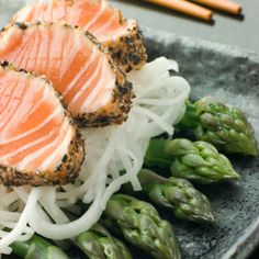 Bikini-Body Secrets from the People Who Know Best: Fight bloat with foods like salmon and asparagus