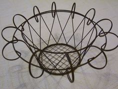 Emily has loaned us a wire basket similar to this to use in our decorations. How shall we use it?