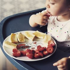Strawberries and bananas on porcelain plate with the fruit of the cacao from 'Hungry Noso' collection