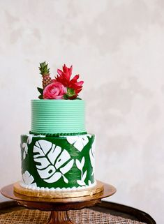Love the tiny pineapple and flowers on top! | Tropical Wedding Cake