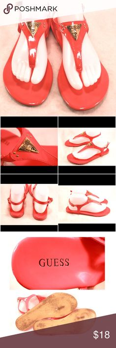 """GUESS Hot Pink Thong Sandals GUESS Hot Pink Thong Sandals in Ladies Size 9M.  All Man Made Materials with Silver Tone Hardware and a Signature Guess """"Jewel"""" Attached. Ink Size 9 on Bottom of left shoe.  Moderate wear on sole.  Insole and upper look great.  Orig. $68. Guess Shoes Sandals"""