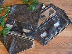 The Elk Canyon Table Runners & Placemats will make a charming addition to your rustic dining room table by adorning it in stunning wildlife imagery. A handsome, bugling elk is showcased with a stylish pinecone and tree leaf pattern while the faux tooled leather material running throughout creates an elegant look you'll treasure for years to come.