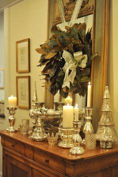 Shiny silver mercury glass Christmas decor and magnolia leaf wreath Silver Christmas, Elegant Christmas, Noel Christmas, Christmas Lights, Christmas Wreaths, Southern Christmas, Outdoor Christmas, Simple Christmas, Beautiful Christmas Decorations
