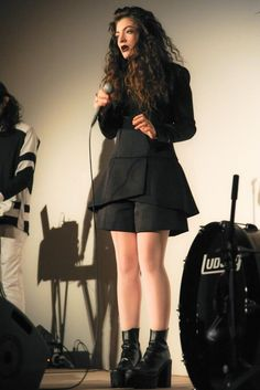 Lordes' style is awesome because she takes the goth-look and turns it into her own personal style