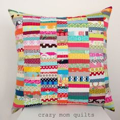 "Another day, another pillow. (Hee hee!) This one is pieced much like my scrap happy purse. I like it in pillow form very much! It uses strips that start about 1"" wide or so.... because I just can't se"