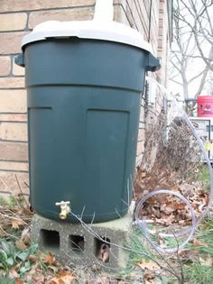 This is not a garbage can. It's a rain barrel.